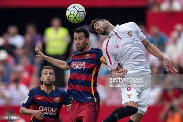 Vicente Iborra of Sevilla FC wins the header after Sergio Busquets Burgos of FC Barcelona during the La Liga match between Sevilla FC and FC...