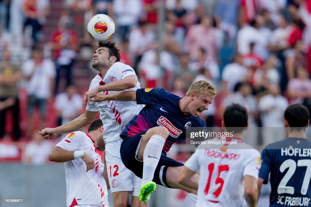 <a gi-track='captionPersonalityLinkClicked' href=/galleries/search?phrase=Vicente+Iborra&family=editorial&specificpeople=7508257 ng-click='$event.stopPropagation()'>Vicente Iborra</a> of Sevilla FC wins the header against <a gi-track='captionPersonalityLinkClicked' href=/galleries/search?phrase=Mike+Hanke&family=editorial&specificpeople=206515 ng-click='$event.stopPropagation()'>Mike Hanke</a> of SC Freiburg during the UEFA Europa League group H match between Sevilla FC and SC Freiburg at Estadio Ramon Sanchez Pizjuan on October 3, 2013 in Seville, Spain.