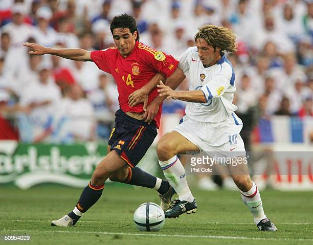 Vicente of Spain battles with Aleksandr Mostovoy of Russia during the Spain v Russia Group A match in the 2004 UEFA European Football Championships...