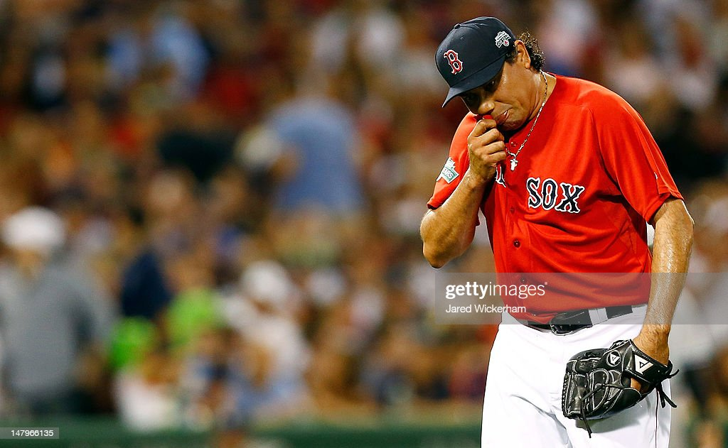 Vicente Padilla #44 of the Boston Red Sox wipes the sweat off of his face after being pulled from the game against the New York Yankees during the game on July 6, 2012 at Fenway Park in Boston, Massachusetts.