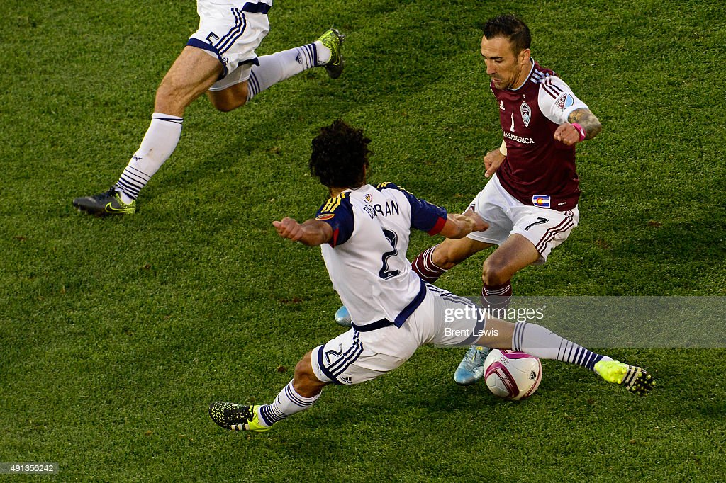 Vicente Sanchez of Colorado Rapids tries to shake the defense of Tony Beltran of Real Salt Lake during the second half October 4 2015 at Dick's...