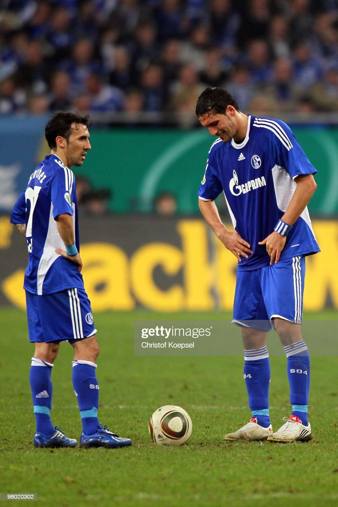 Vicente Sanchez of Schalke and Kevin Kuranyi of Schalke look dejected after the first goal of Bayern during the DFB Cup semi final match between FC Schalke 04 and FC Bayern Muenchen at Veltins Arena on March 24, 2010 in Gelsenkirchen, Germany.