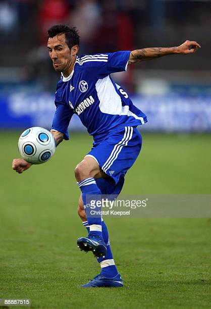 Vicente Sanchez of Schalke runs with the ball during the preseason friendly match between FC Schalke 04 and Twente Enschede at the Vivaris Arena on...