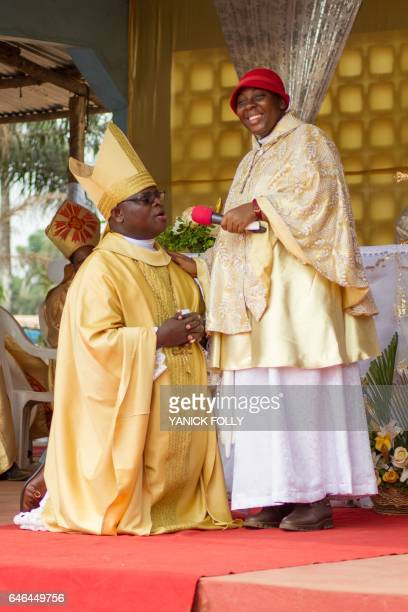 Vicentia Tadagbe Tchranvoukinni who calls herself 'Perfect' and 'God holy spirit' stands next to Mathias Vignan alia Pope Christophe XVIII of the...