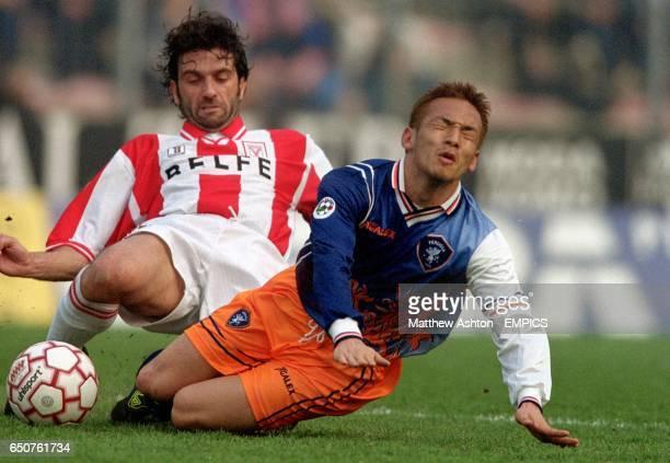 Vicenza's Fabio Viviani brings down Perugia's Hidetoshi Nakata