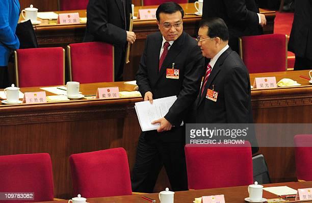 VicePremier Li Keqiang shares a word with politburo member and propaganda chief Li Changchun following the annual work report by Premier Wen Jiabao...