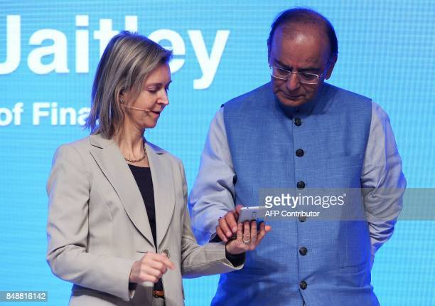 Vicepresident and head of finance and commerce products on Googles Next Billion Users team Diana Layfield and Finance Minister of India Arun Jaitley...