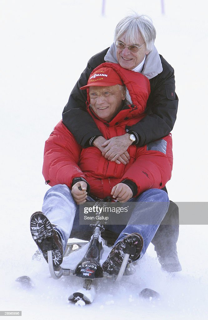 Vice-President Bernie Ecclestone (back) and former Formula One World Champion <a gi-track='captionPersonalityLinkClicked' href=/galleries/search?phrase=Niki+Lauda&family=editorial&specificpeople=218060 ng-click='$event.stopPropagation()'>Niki Lauda</a> of Austria attend the Kitz Charity Trophy at the Hahnenkamm Ski Races January 24, 2004 in Kitzbuehel, Austria.
