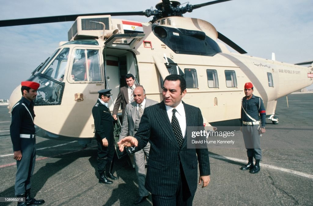 Vice-President <a gi-track='captionPersonalityLinkClicked' href=/galleries/search?phrase=Hosni+Mubarak&family=editorial&specificpeople=201752 ng-click='$event.stopPropagation()'>Hosni Mubarak</a> arrives in Cairo after traveling in the Egyptian presidential helicopter, Egypt, 1977.