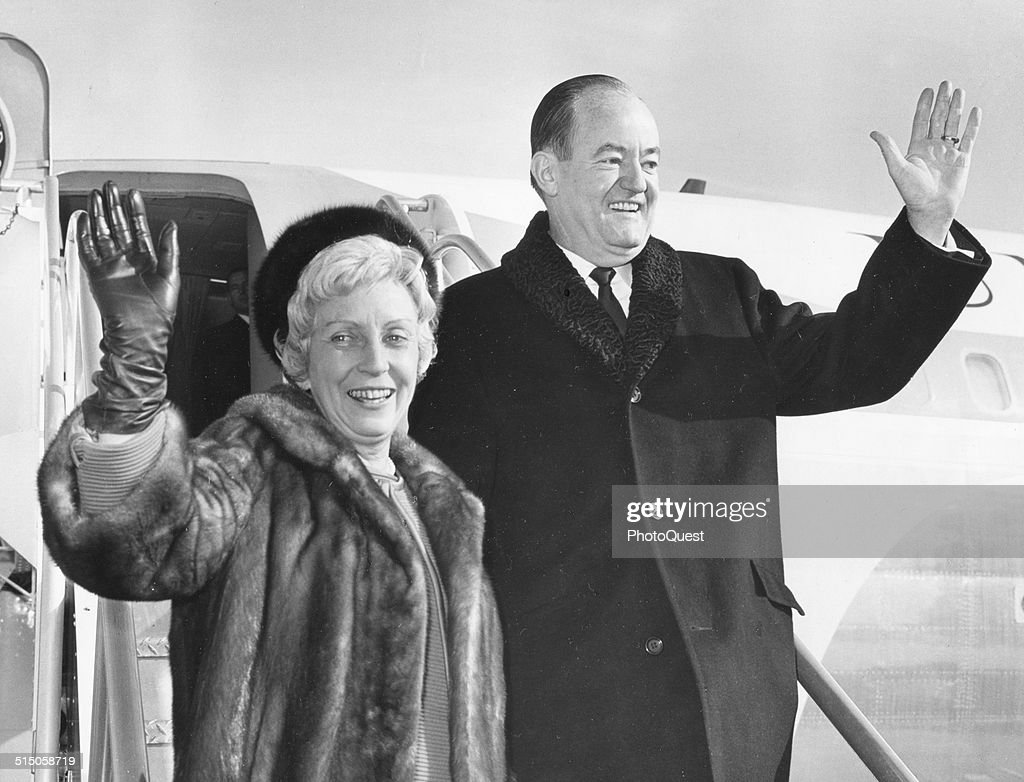 Vice-President Hubert H Humphrey and his wife Muriel wave as they depart from a Asian trip, Washington DC, January 3, 1966.