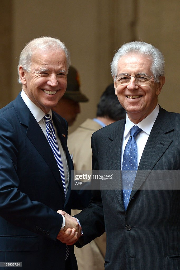 US Vice-President Joe Biden is welcomed by Italian outgoing Prime Minister Mario Monti (R) at Palazzo Chigi in Rome on March 18, 2013. Joe Biden arrived in Rome late to attend Pope Francis's inauguration mass.