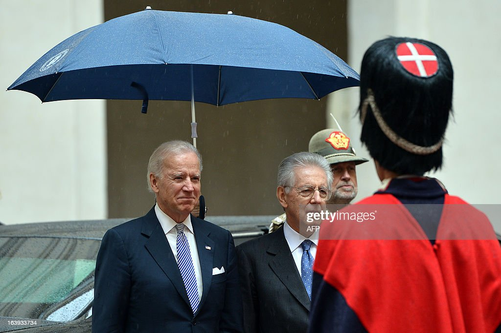 US Vice-President Joe Biden is welcomed by Italian outgoing Prime Minister Mario Monti (R) at Palazzo Chigi in Rome on March 18, 2013. Joe Biden arrived in Rome late Sunday to attend Pope Francis's inauguration mass.