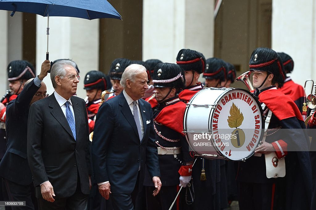 US Vice-President Joe Biden is welcomed by Italian outgoing Prime Minister Mario Monti (L) at Palazzo Chigi in Rome on March 18, 2013. Biden is in Italy to attend the inaugural mass of newly-elected Pope Francis, which is to be held at the Vatican on Tuesday.