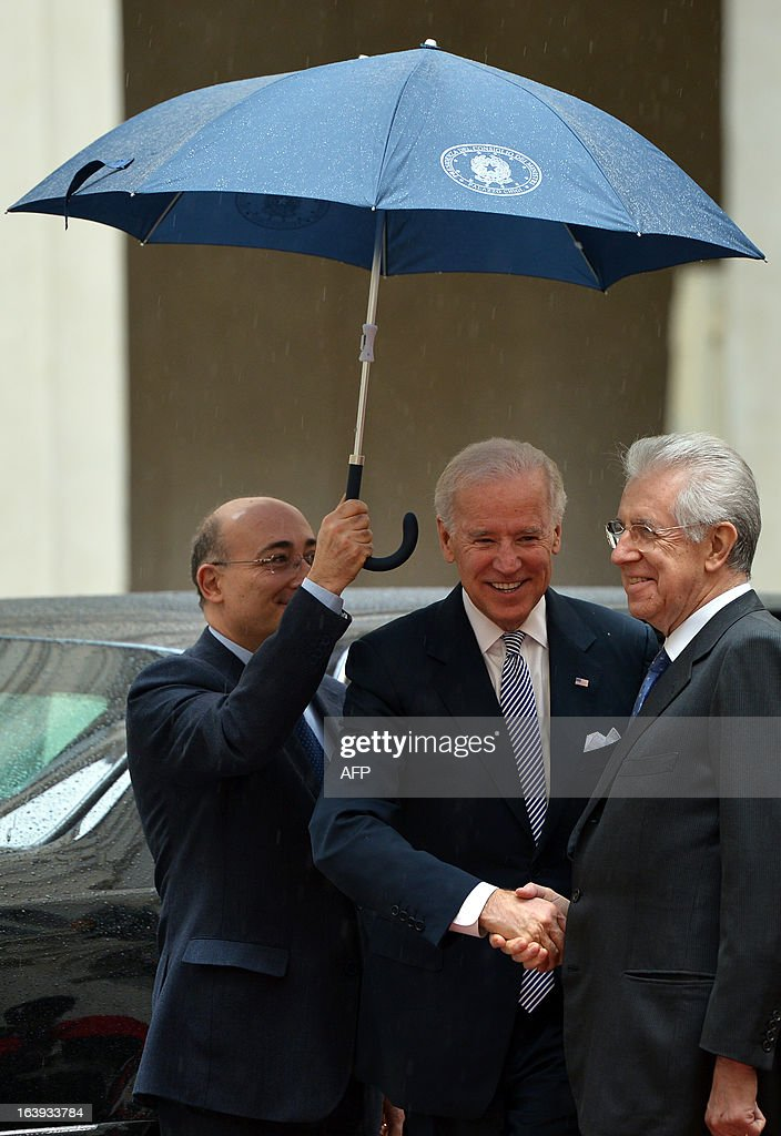 US Vice-President Joe Biden is welcomed by Italian outgoing Prime Minister Mario Monti (R) at Palazzo Chigi in Rome on March 18, 2013. Joe Biden arrived in Rome to attend Pope Francis's inauguration mass tomorrow.