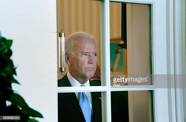 VicePresident Joe Biden looks on during a bilateral meeting between President Obama and President Petro Poroshenko of Ukraine in the Oval Office of...