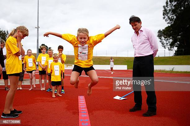 IAAF vicePresident Lord Sebastian Coe helps young children attending an IAAF Kids Athletics Event at the AUT Millennium Institute on February 4 2015...