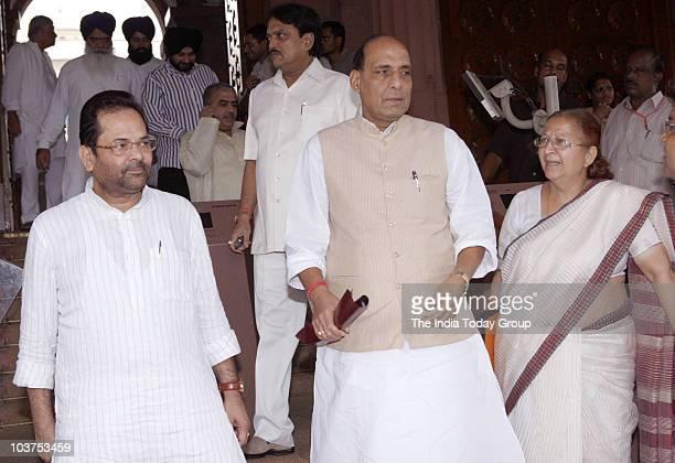 BJP vicepresident Mukhtar Abbas Naqvi former BJP chief Rajnath Singh and BJP leader Sumitra Mahajan outside Parliament in New Delhi on Tuesday August...