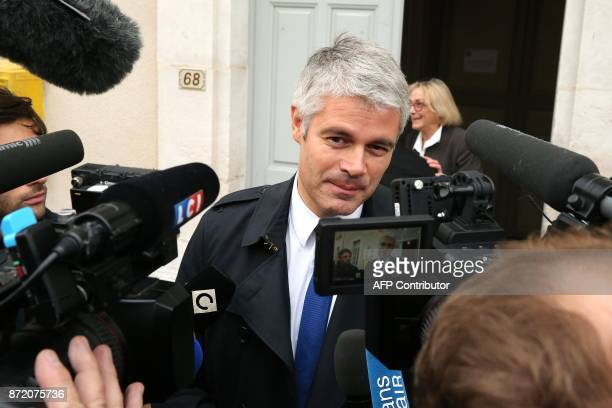VicePresident of French rightwing Les Republicains party and candidate for the LR presidency Laurent Wauquiez addresses the media as he comes to pay...