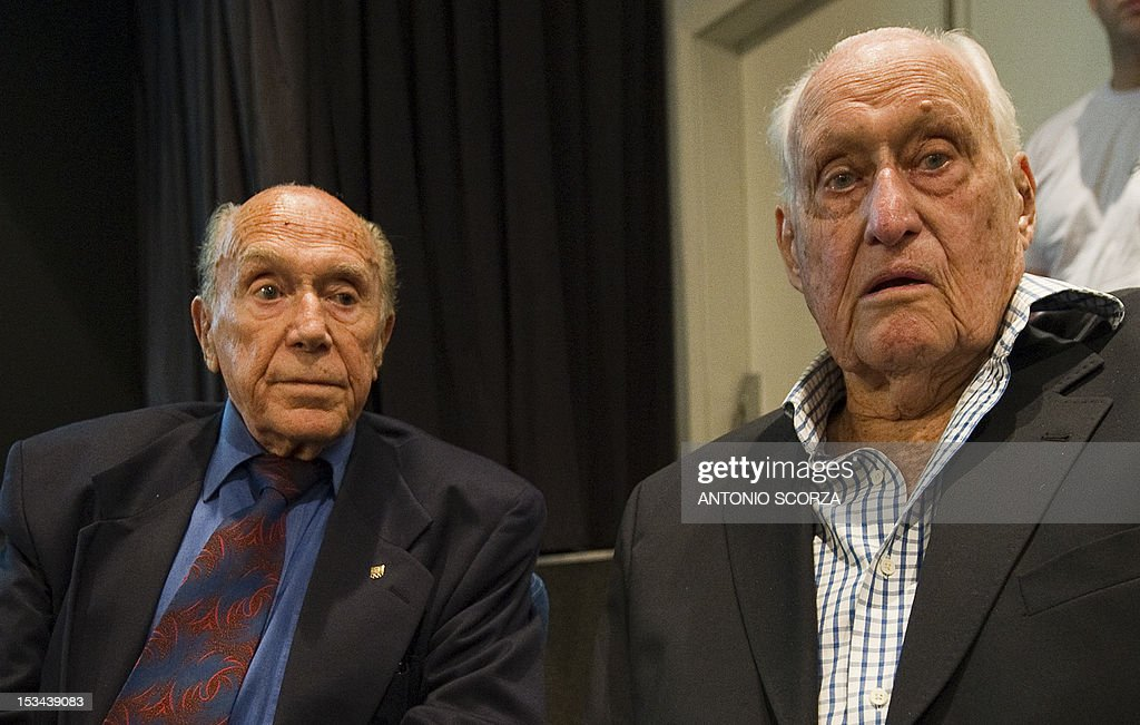 Vice-president of the Brazilian Olympic Committee organizing committee Andre Richer (L) speaks with former FIFA president Joao Havelange (R) during the opening ceremony of the General Assembly of the Rio 2016 Olympic organizing committee on October 5, 2012 in Rio De Janeiro, Brazil. The assembly will elect new authorities of the committee.