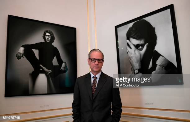Vicepresident of the Fondation BergeSaint Laurent and husband of late cofounder of fashion house Yves SaintLaurent Pierre Berge Madison Cox poses for...