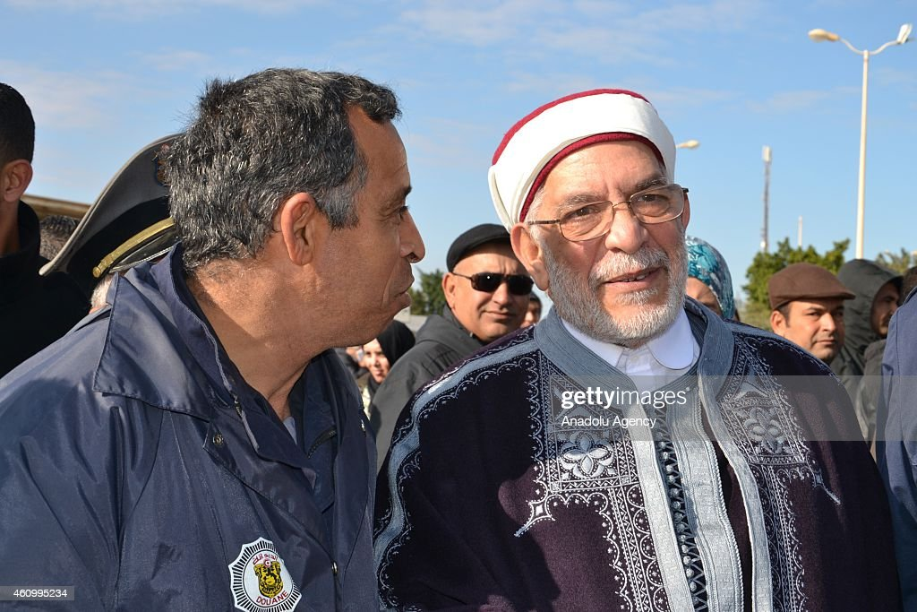 Vice-President of the Tunisian People's Assembly, Abdelfattah Mourou (R) and Tunisian parliament speaker, <a gi-track='captionPersonalityLinkClicked' href=/galleries/search?phrase=Mohammed&family=editorial&specificpeople=3955327 ng-click='$event.stopPropagation()'>Mohammed</a> Nasser (not seen) talk with the Tunisian soldiers at the Tunisian-Libyan border gate to celebarete the 1444th anniversary for the celebration of Mawlid al-Nabi, holy day for the birthday of the Islam's prophet Muhammad, in Ras Jdir, Tunisia on January 03, 2015.
