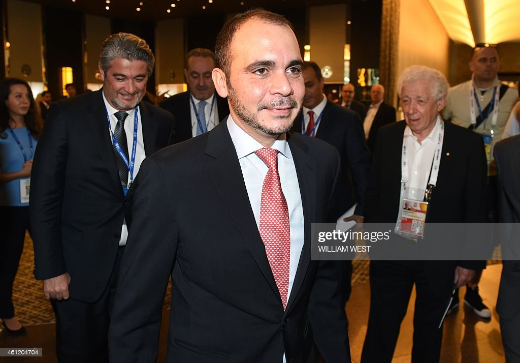 FIFA vice-president Prince Ali bin Al Hussein of Jordon (C) arrives for the Asian Football Confederation (AFC) Extraordinary Congress meeting in Melbourne before the start of the AFC Asian Cup on January 9, 2015. Asia's top sports leaders refused to back Prince Ali bin Al Hussein's election challenge to FIFA president Sepp Blatter and insisted it was doomed to failure. AFP PHOTO / William WEST --IMAGE RESTRICTED TO EDITORIAL USE - STRICTLY NO COMMERCIAL USE--