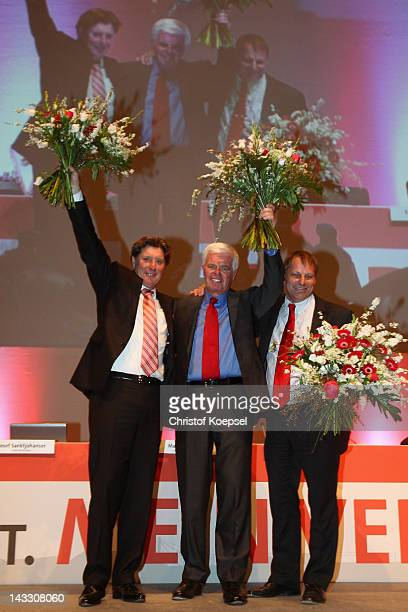 Vicepresident Toni Schumacher new president Werner Spinner and vicepresident Markus Ritterbach pose after being voted during the extraordinary...
