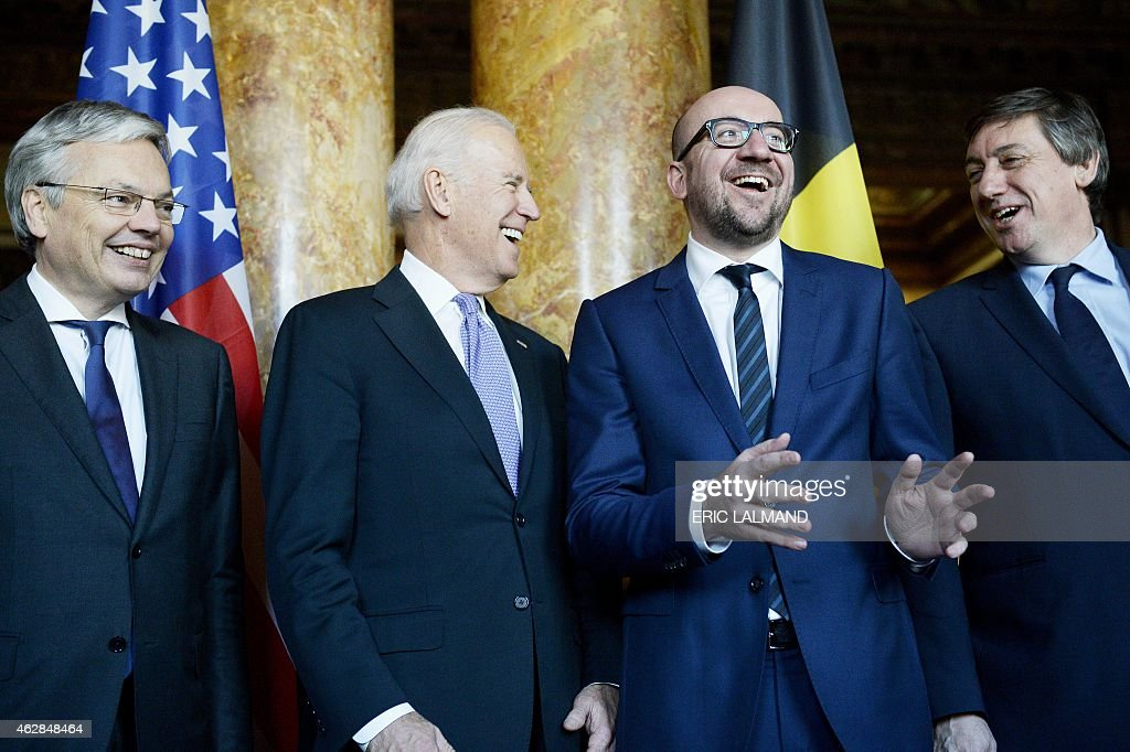 Vice-Prime Minister and Foreign Minister Didier Reynders, US Vice-President Joe Biden, Belgian Prime Minister Charles Michel and Vice-Prime Minister and Interior Minister Jan Jambon laugh during a meeting at the Egmont Palace in Brussels on February 6, 2015. AFP PHOTO / BELGA / ERIC LALMAND