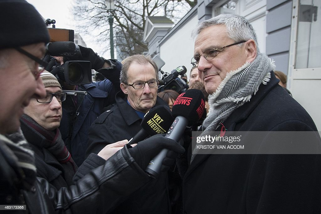 Vice-Prime Minister and Minister of Employment, Economy and Consumer Affairs, <a gi-track='captionPersonalityLinkClicked' href=/galleries/search?phrase=Kris+Peeters&family=editorial&specificpeople=2203934 ng-click='$event.stopPropagation()'>Kris Peeters</a> (C), talks to the press as he arrives for a meeting of the Group of 10 (Groep van 10 - Groupe de 10) and ministers of the Federal Government in Brussels, on February 11, 2015. The group of 10 is a selection of social partners including unions representatives and employers organizations.