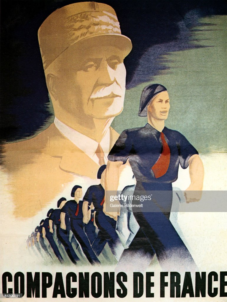 A Vichy Government poster depicts the Vichy Chief of State Philippe Petain (1856 - 1951) above a line of teenage boys from the youth organisation Compagnons de France, circa 1940.