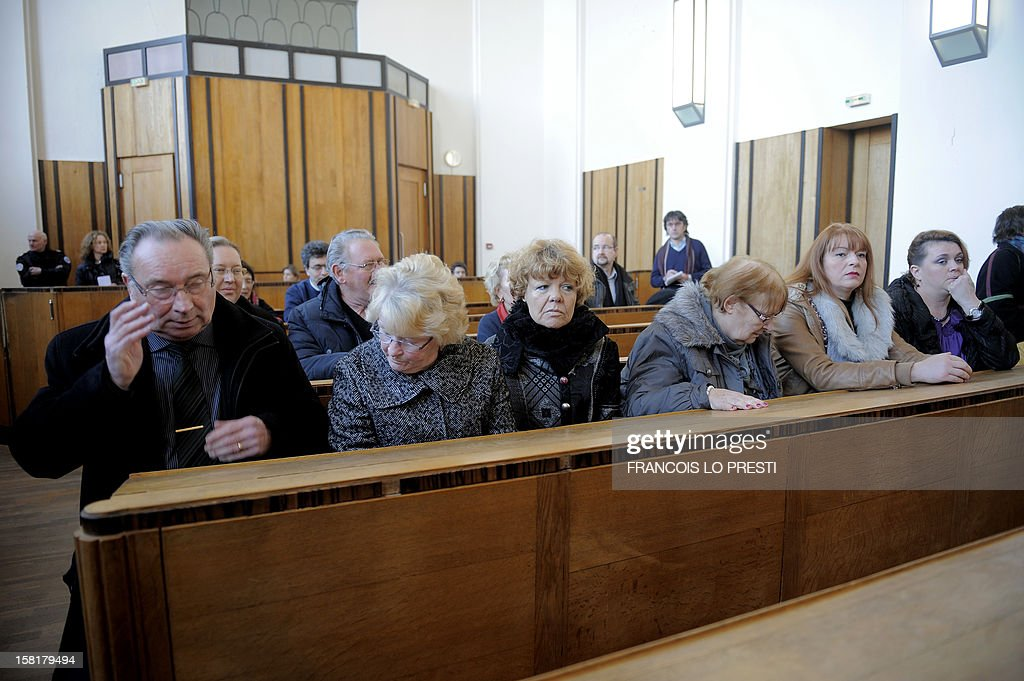 Vicitms and families of victims sit in the Bethune courthouse, northern France on December 10, 2012 during the opening day of the trial against petrochemical plant Noroxo for contanimination. Noroxo, part of the Exxon Mobile group, the world's biggest oil producer is tried in a case of an epidemic legionellosis , whose source of contamination was identified as the Noroxo factory in Harnes, and contracted over the 2003 and 2004 period making 83 victims, fourteen of which died. AFP PHOTO / Francois LO PRESTI