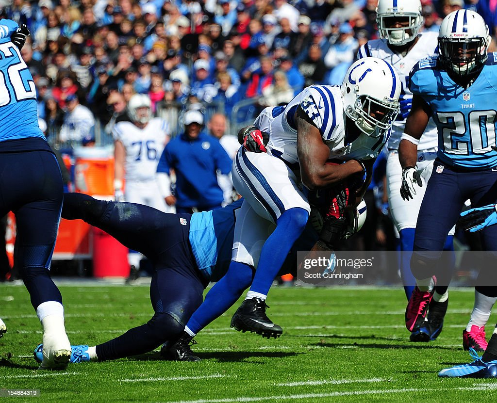 Vick Ballard #33 of the Indianapolis Colts carries the ball against Jordan Babineaux #26 of the Tennessee Titans at LP Field on October 28, 2012 in Nashville, Tennessee.