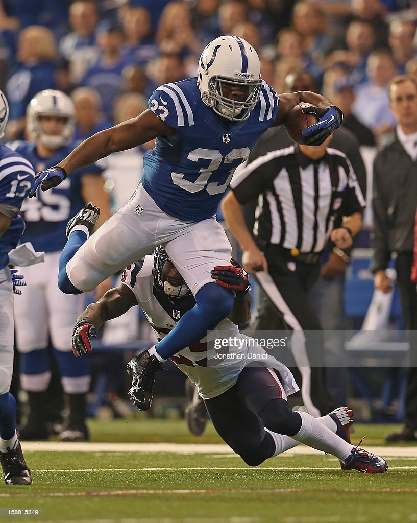 <a gi-track='captionPersonalityLinkClicked' href=/galleries/search?phrase=Vick+Ballard&family=editorial&specificpeople=7265928 ng-click='$event.stopPropagation()'>Vick Ballard</a> #33 of the Indianapolis Colts is grabbed by <a gi-track='captionPersonalityLinkClicked' href=/galleries/search?phrase=Kareem+Jackson&family=editorial&specificpeople=3908085 ng-click='$event.stopPropagation()'>Kareem Jackson</a> #25 after picking up a first down of the Houston Texans at Lucas Oil Stadium on December 30, 2012 in Indianapolis, Indiana.