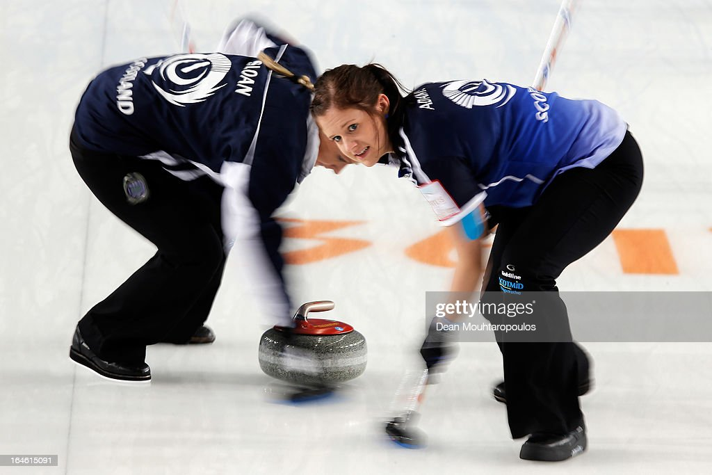 Vicki Adams (R) and Anna Sloan sweep during the Gold medal match between Sweden and Scotland on Day 9 of the Titlis Glacier Mountain World Women's Curling Championship at the Volvo Sports Centre on March 24, 2013 in Riga, Latvia.