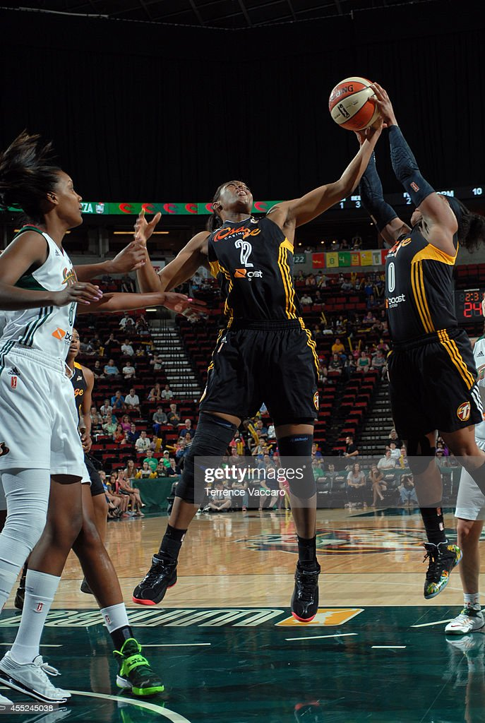 Vicki Baugh #22 of the Tulsa Shock rebounds the ball against the Seattle Storm during the game on August 10,2014 at Key Arena in Seattle, Washington.