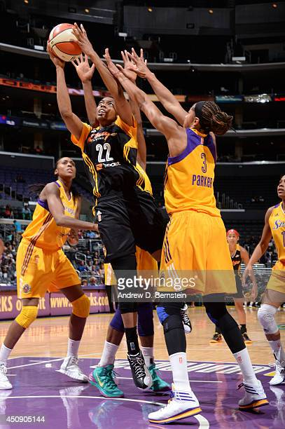 Vicki Baugh of the Tulsa Shock shoots against Candace Parker of the Los Angeles Sparks at STAPLES Center on June 19 2014 in Los Angeles California...
