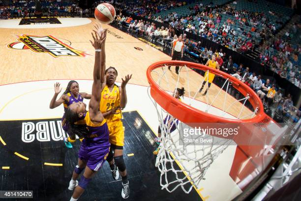 Vicki Baugh of the Tulsa Shock shoots against Sandrine Gruda of the Los Angeles Sparks during the WNBA game on June 28 2014 at the BOK Center in...