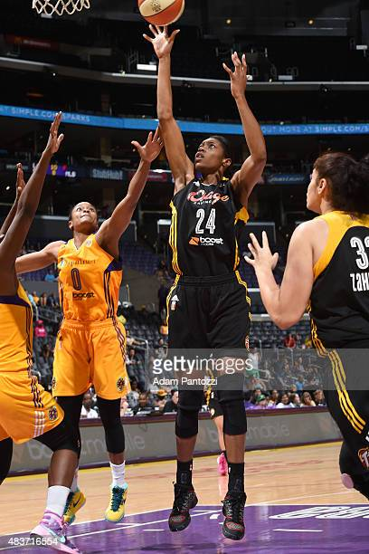 Vicki Baugh of the Tulsa Shock shoots the ball against Alana Beard of the Los Angeles Sparks at Staples Center on August 06 2015 in Los Angeles...