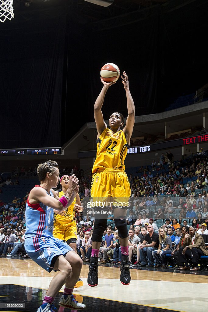 Vicki Baugh #22 of the Tulsa Shock shoots the ball against Celine Dumerc #9 of the Atlanta Dream during the WNBA game on July 29, 2014 at the BOK Center in Tulsa, Oklahoma.