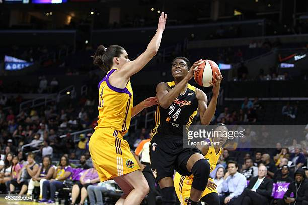 Vicki Baugh the Tulsa Shock handles the ball against Marianna Tolo of the Los Angeles Sparks in a WNBA game at Staples Center on August 6 2015 in Los...