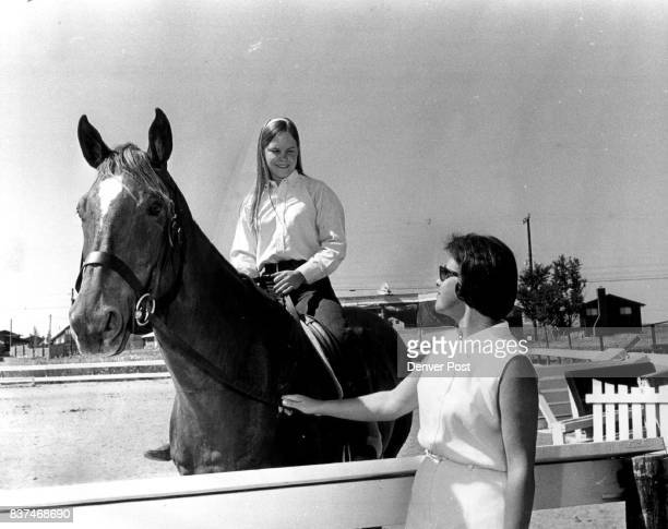 Vicki Emery Riding Telegram Practices for Benefit Her mother Mrs Walter Emery watches practice at Arapahoe Riding club where US Equestrian Team...