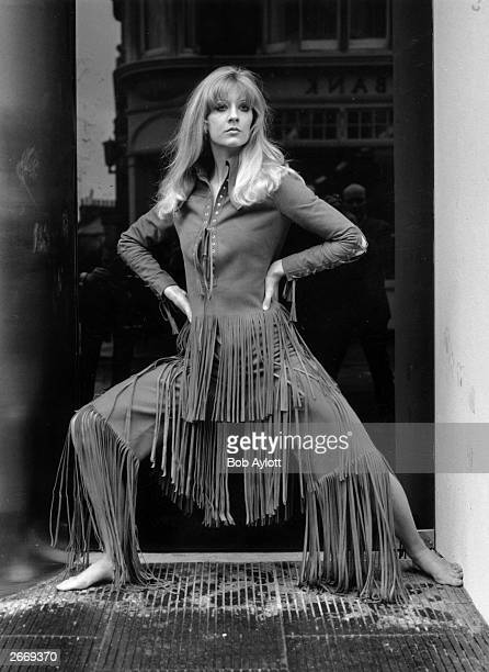 Vicki Hodge models 'Marisa' a rough suede trouser suit with long fringe part of the Ossie Clark and Alice Pollock collection on show at the Querum...