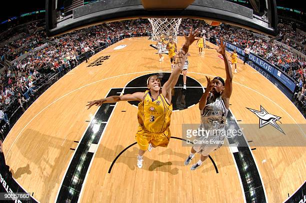 Vicki Johnson of the San Antonio Silver Stars shoots against Candace Parker of the Los Angeles Sparks on September 5 2009 at the ATT Center in San...