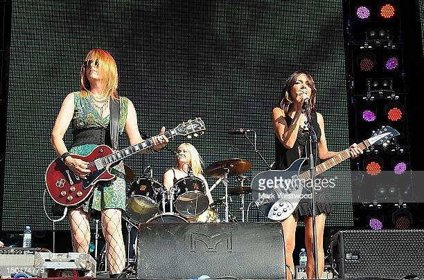 Vicki Peterson Debbi Peterson and Susanna Hoffs of The Bangles perform on stage during 80's Rewind Festival on August 18 2012 in HenleyonThames...