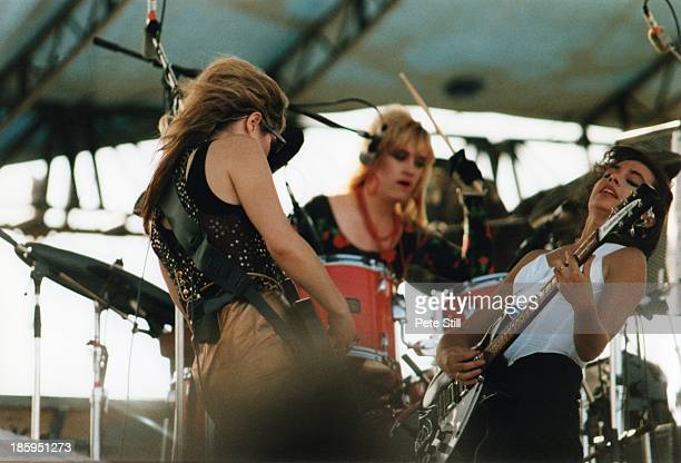 Vicki Peterson drummer Debbi Peterson and Susanna Hoffs of The Bangles perform on stage at Milton Keynes Bowl on June 21st 1986 in Buckinghamshire...