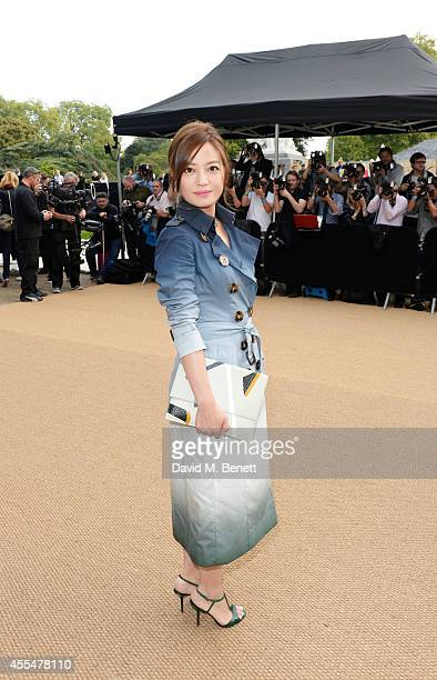 Vicki Zhao attends the Burberry Womenswear SS15 show during London Fashion week at Kensington Gardens on September 15 2014 in London England