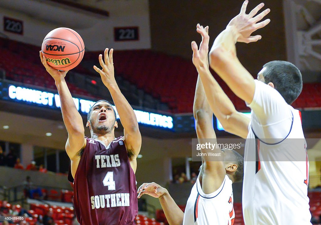 Vicktor Arnick #4 of the Texas Southern Tigers drives to the basket during game against the Texas Tech Red Raiders on November 18, 2013 at United Spirit Arena in Lubbock, Texas. Texas Tech won the game 80-71.