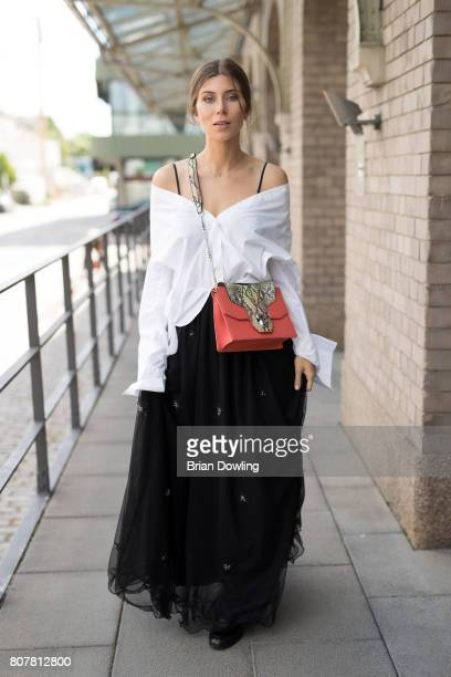 Vicky Heiler poses at the Marc Cain street style shooting during MercedesBenz Fashion Week Berlin Spring/Summer 2018 on July 4 2017 in Berlin Germany