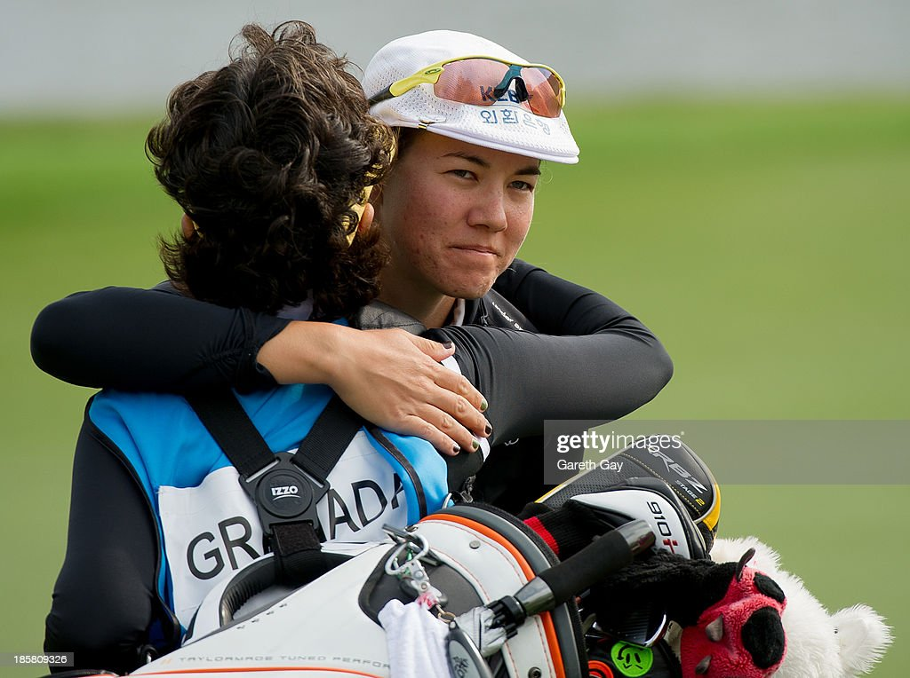 <a gi-track='captionPersonalityLinkClicked' href=/galleries/search?phrase=Vicky+Hurst&family=editorial&specificpeople=777789 ng-click='$event.stopPropagation()'>Vicky Hurst</a> of U.S.A hugs team mates after finishing the 18th hole during day two of the Sunrise LPGA Taiwan Championship on October 25, 2013 in Taoyuan, Taiwan.