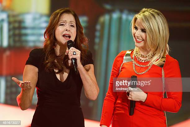 Vicky Leandros and Beatrice Egli perform during the 'Willkommen bei Carmen Nebel' show at Volkswagen Halle on November 23 2013 in Braunschweig Germany